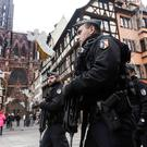 French police officers patrol next to Notre-Dame cathedral of Strasbourg following a shooting in the city of Strasbourg, eastern France, Wednesday, Dec. 12, 2018. (AP Photo/Jean Francois Badias)