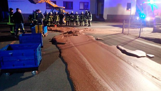 Spilt chocolate is seen on a road in Werl, Germany December 10, 2018 in this picture obtained from social media. Picture taken December 10, 2018. FEUERWEHR WERL/via REUTERS