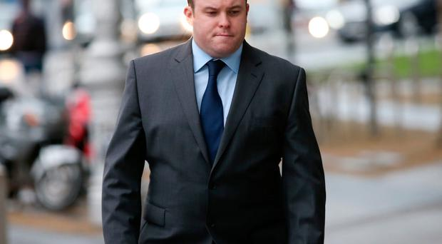 Garda Warren Farrell (35), who is based in Clondalkin, Co Dublin, arrives at the Dublin Circuit Criminal Court where he is accused of dangerous driving causing the death of a woman four years ago. Pic Collins Courts.