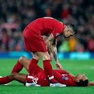 Soccer Football - Champions League - Group Stage - Group C - Liverpool v Napoli - Anfield, Liverpool, Britain - December 11, 2018 Liverpool's Joel Matip reacts after going down as Dejan Lovren stands over him REUTERS/Jon Super