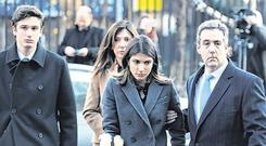 Former Trump lawyer Michael Cohen arrives at federal court accompanied by his wife and children. Photo: Reuters