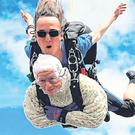 102-year-old Irene O'Shea during her tandem skydive. Photo: Getty Images