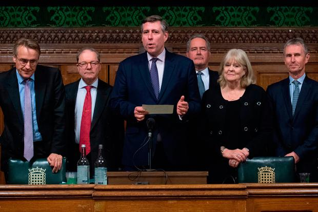 Sir Graham Brady (centre), chairman of the 1922 Committee, announces that Theresa May has survived an attempt by Tory MPs to oust her as party leader. Photo credit: Stefan Rousseau/PA Wire