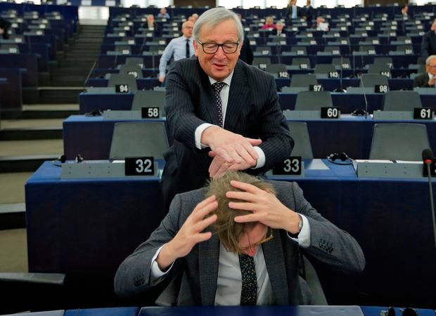 Crunch time: EC President Jean-Claude Juncker jokes with EU Brexit negotiator Guy Verhofstadt earlier this year. Photo: REUTERS