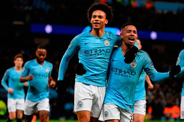 Manchester City's German midfielder Leroy Sane (C) celebrates with Manchester City's Brazilian striker Gabriel Jesus (R) after scoring their first goal during the UEFA Champions League group F football match between Manchester City and Hoffenheim at the Etihad stadium in Manchester, north west England on December 12, 2018. (Photo by Paul ELLIS / AFP)PAUL ELLIS/AFP/Getty Images