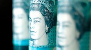 FILE PHOTO: British five pound banknotes are seen in this picture illustration taken November 14, 2017. REUTERS/ Benoit Tessier/Illustration/File Photo