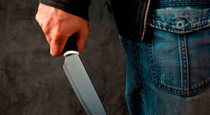 The hooded man was carrying a knife as he stole the money. (Stock picture)
