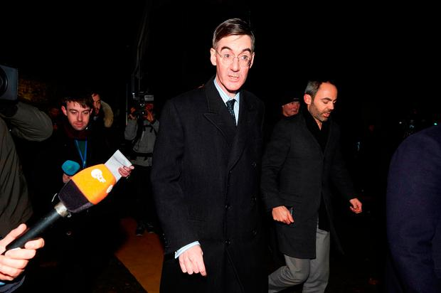 Conservative MP Jacob Rees-Mogg speaks to the media next to Parliament. NIKLAS HALLE'N/AFP/Getty Images