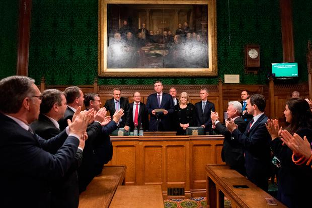 Challenge: MPs applaud as Graham Brady (centre) announces that Theresa May survived an attempt to oust her. Photo: PA