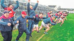 What a moment: Subs and staff supporting Mullinalaghta go wild at the final whistle. Photo: Daire Brennan/Sportsfile