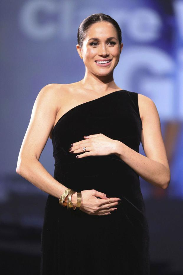 Surprise, surprise: Meghan Markle turned up at the British Fashion Awards to present Clare Waight Keller of Givenchy with a gong. Photo: Tristan Fewings/BFC