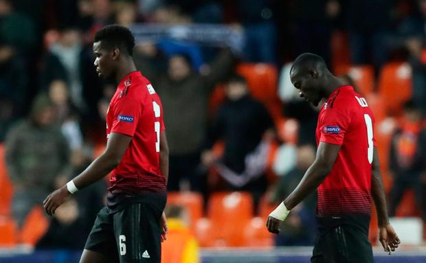 Manchester United's Paul Pogba and Eric Bailly dejected after the match