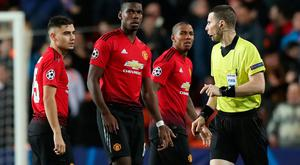 Manchester United's Andreas Pereira, Paul Pogba, Ashley Young and referee Georgi Kabakov look on