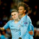 Manchester City's Leroy Sane celebrates with Phil Foden