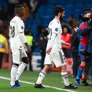 Real Madrid's Vinicius Junior and Isco react after the match