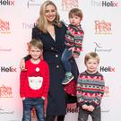 Anna Daly with her sons James, Evan and Rhys at the opening night of Robin Hood panto at The Helix. Picture: Leon Farrell/Photocall Ireland