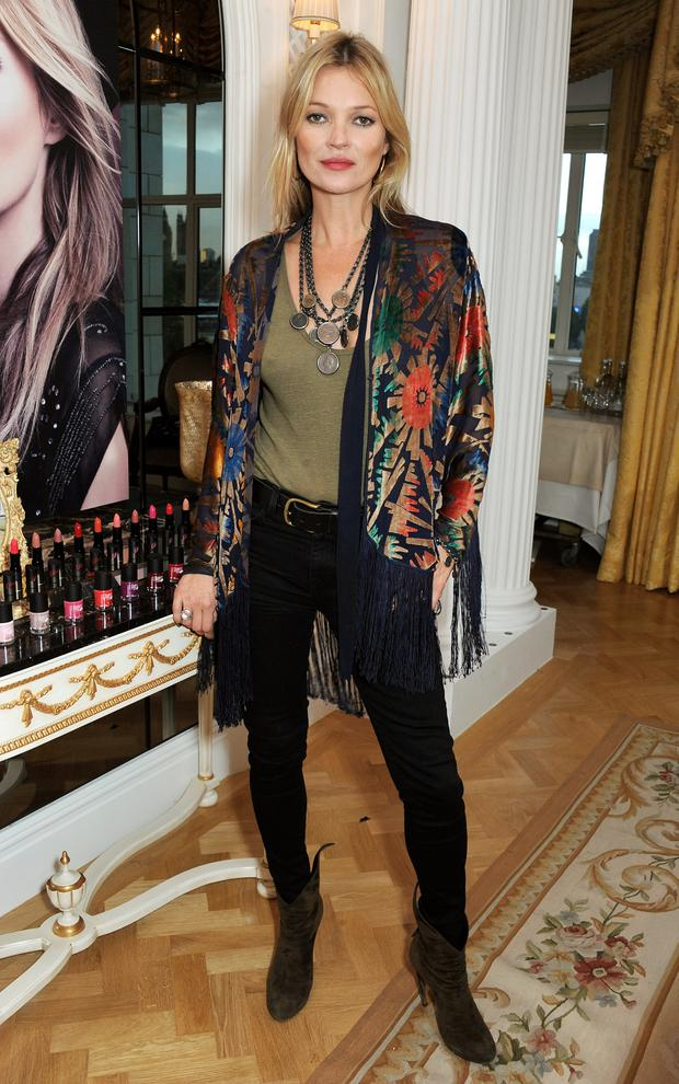 Kate Moss attends the Rimmel London 180 Years Of Cool photocall at The Savoy Hotel on October 10, 2013 in London, England. (Photo by David M. Benett/Getty Images for Rimmel London)
