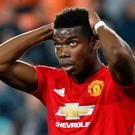 Manchester United's Paul Pogba reacts after missing a chance to score during a Group H Champions League soccer match between Valencia and Manchester United at the Mestalla Stadium