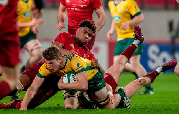 Munster's Daniel Okeke tackles Max Douglas. Photo: ©INPHO/Morgan Treacy