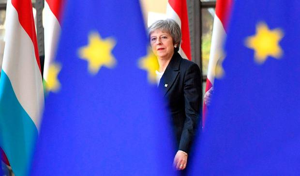 Stuck in the middle: British Prime Minister Theresa May at an EU meeting in Brussels yesterday. AP Photo/Geert Vanden Wijngaert