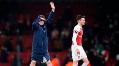 Arsenal's Laurent Koscielny (left) waves to the fans at the end of the game. Photo: Adam Davy/PA Wire
