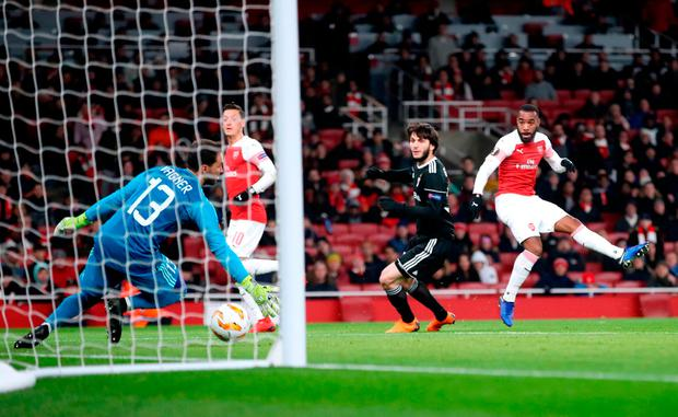 Alexandre Lacazette (right) scores Arsenal's only goal of the evening. Photo: Adam Davy/PA Wire