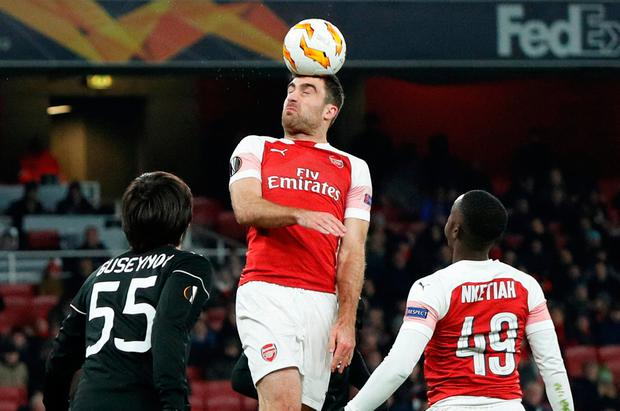 Arsenal's Sokratis Papastathopoulos is first to the ball. Photo: Action Images via Reuters/John Sibley
