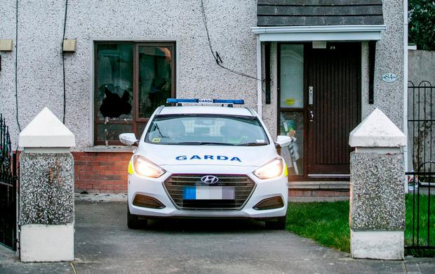 A garda car outside a house in Drogheda which was badly damaged when a petrol bomb was hurled inside as a mum and her four children were sleeping