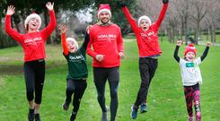 Dublin star Cian O'Sullivan with Caoimhe (13), Rossa (9), Cuan (11) and Saoirse (6) Moore at the launch of the 37th GOAL Mile in Dublin. People of all ages are encouraged to join their local mile this Christmas – visit www.goalmile.org for details. Photo: Leon Farrell/Photocall Ireland