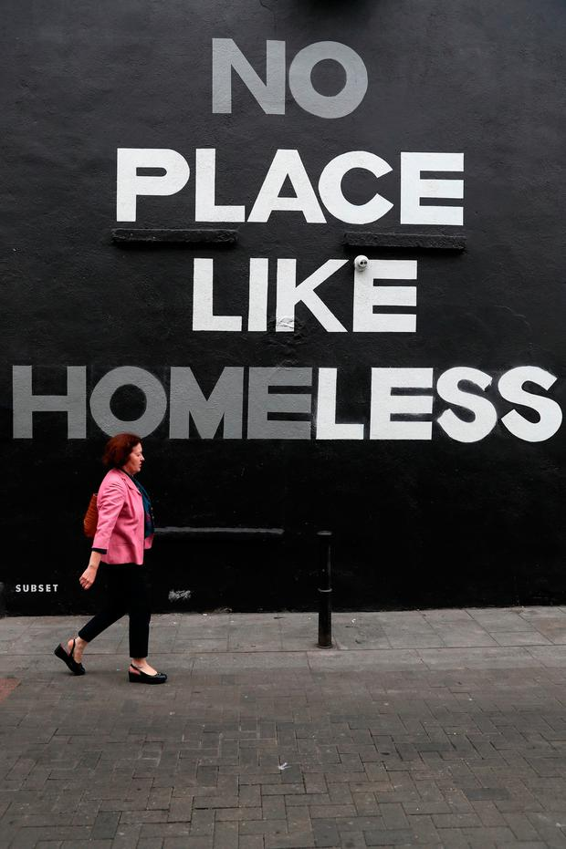 A woman walks by a mural in Dublin city centre. Picture: PA