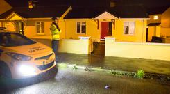 Gardaí at the house in Portlaw. Photo: Patrick Browne