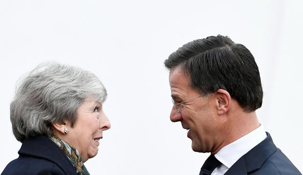 British Prime Minister Theresa May is welcomed by Dutch Prime Minister Mark Rutte ahead of a meeting in the Hague, the Netherlands, December 11, 2018. REUTERS/Piroschka van de Wouw/File Photo