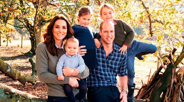 This photograph taken in the Autumn by Matt Porteous, shows The Duke and Duchess of Cambridge with their three children, Prince Louis, Princess Charlotte and Prince George (right) at Anmer Hall in Norfolk