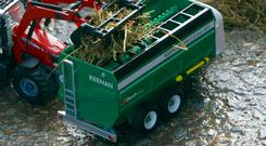 The Britains Keenan MechFiber 365 die cast replica model mixer wagon.
