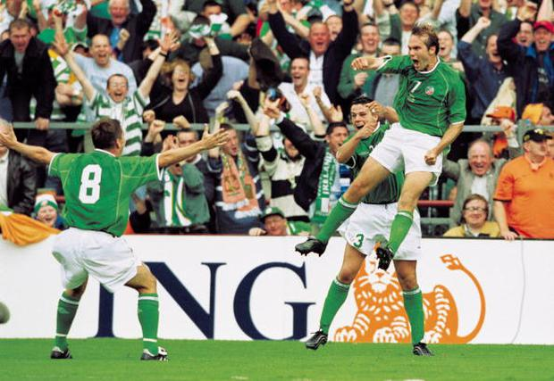 Jason McAteer of the Republic of Ireland celebrates his winning goal during the World Cup Qualifier against Holland at Lansdowne Road: Jamie McDonald /Allsport