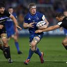 Dan Leavy of Leinster is tackled by Jamie Roberts of Bath during their Champions Cup match on December 08, 2018. (Bryn Lennon/Getty Images)