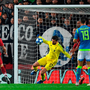 Alisson is at full stretch as he saves Liverpool's Champions League hopes against Napoli. Photo: Paul Ellis/Getty Images
