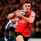 Ulster's Jacob Stockdale on his way to scoring his side's second try despite the efforts of Gareth Davies of Scarlets. Photo: Oliver McVeigh/Sportsfile