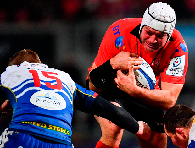 Ulster's Rory Best of Ulster is tackled by Johnny McNicholl of Scarlets. Photo: Ramsey Cardy/Sportsfile