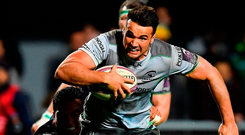 Connacht's Cian Kelleher beats the tackles of Sadek Degmache, left, and Tima Fainga'anuku on the way to scoring his side's fifth try against Perpignan. Photo: Brendan Moran/Sportsfile