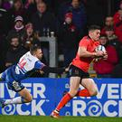 Jacob Stockdale of Ulster beats the tackle by Tom Prydie of Scarlets on his way to scoring his side's second try at the Kingspan Stadium in Belfast. (Photo By Ramsey Cardy/Sportsfile via Getty Images)