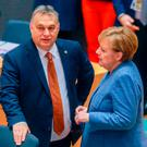 Talks: Hungarian Prime Minister Viktor Orban and German Chancellor Angela Merkel during the second day of the European summit. Picture: AFP/Getty