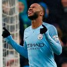 Manchester City's Raheem Sterling celebrates scoring their third goal