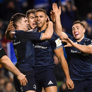 Adam Byrne of Leinster, centre, is congratulated by team-mates after scoring his side's fourth try against Bath