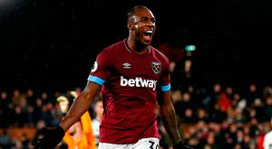 West Ham United's English midfielder Michail Antonio celebrates scoring his team's second goal during the English Premier League football match between Fulham and West Ham United at Craven Cottage in London on December 15, 2018. (Photo by Ian KINGTON / AFP) /