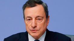 European Central Bank (ECB) President Mario Draghi speaks during a news conference after the bank formally ended its €2.6trn quantitative easing policy. Photo: Reuters