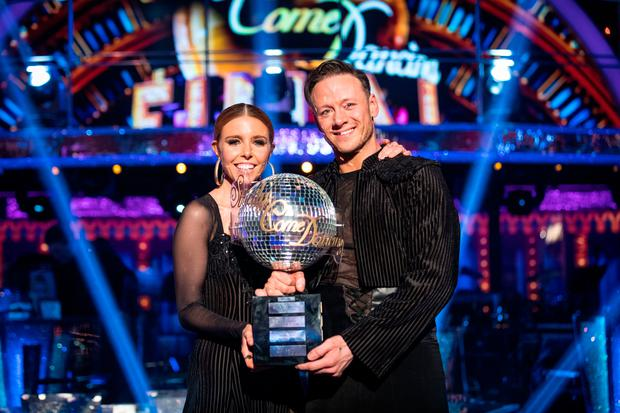 Strictly Come Dancing 2018 winners Kevin Clifton and Stacey Dooley with the glitterball trophy. Guy Levy/BBC/PA Wire