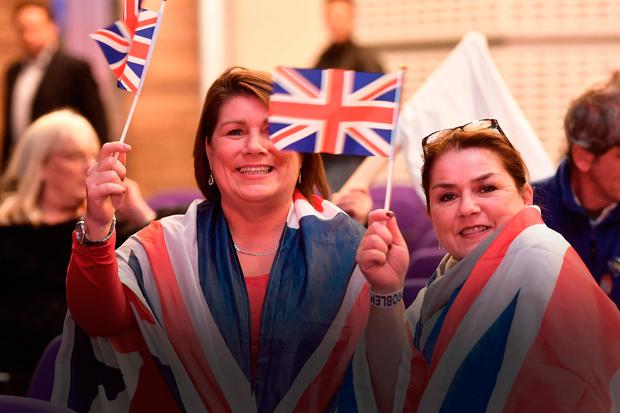 Brexit supporters in the crowd wearing Union flags during a Leave Means Leave