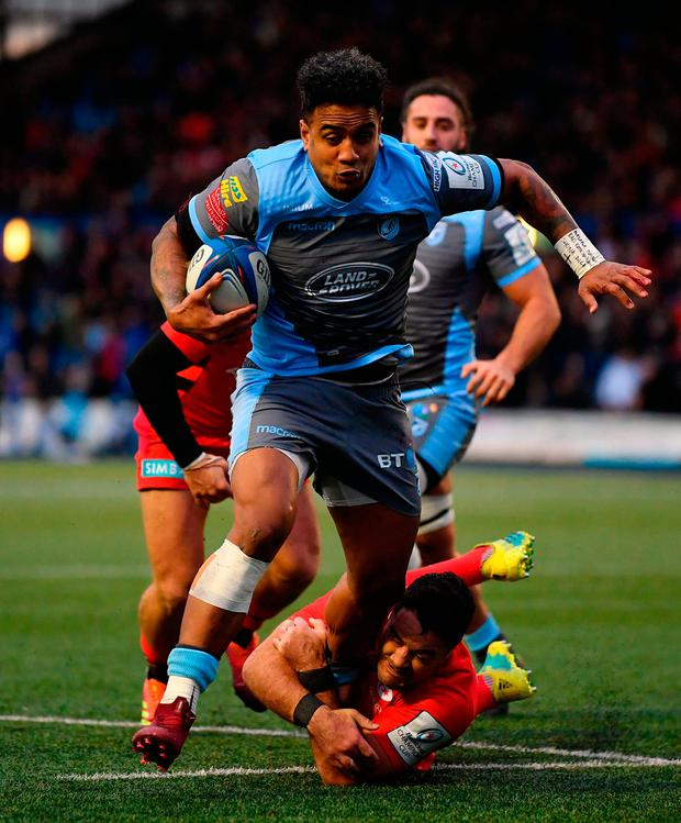 Rey Lee-Lo of Cardiff Blues breaks the tackle of Brad Barritt of Saracens to score his side's first try. Photo: Dan Mullan/Getty Images