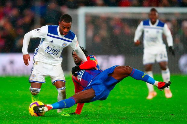 Ricardo Pereira of Leicester City battles for the ball with Jeffrey Schlupp of Crystal Palace during the Premier League match between Crystal Palace and Leicester City at Selhurst Park on December 15, 2018 in London, United Kingdom. (Photo by Dan Istitene/Getty Images)